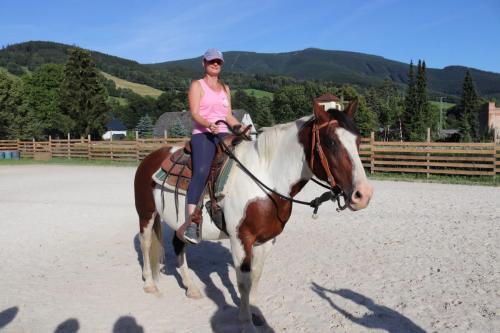 blanka riding a horse